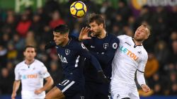 Swansea 0-2 Tottenham: Spurs ease to victory over sluggish Swans